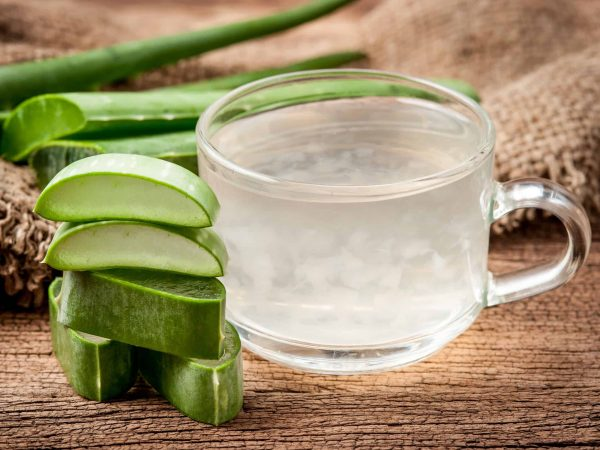 54925029 – aloe vera healthy drink on wooden background