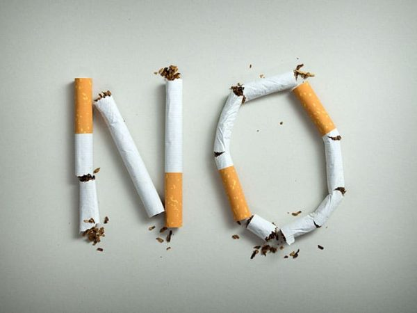 No smoking sign made with broken cigarettes