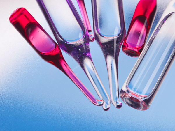 12838753 – medical ampoules on red and blue vivid color background